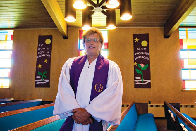 Pastor Bob Woods stands in front of the pews Saturday in First Congregational United Church of Christ. The church is celebrating its 50th anniversary at the 630 Green St. location.