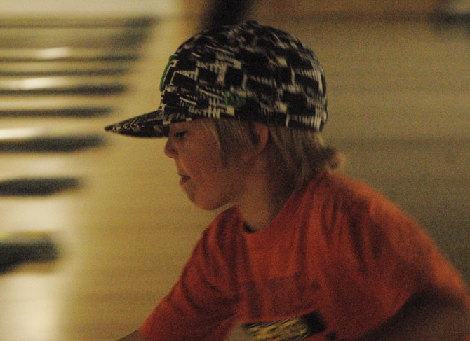 Parker Myers watches his bowling ball roll down the lane Sunday afternoon at Thunder Rolls Bowling Center. Parker, 6, was bowling with his brother, Caleb, and friend Jacinda Newkirk.