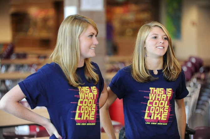 Steamboat Springs High School seniors Charlotte Letson, left, and Jaime Winter talk about the upcoming school year Monday during the first day of school.