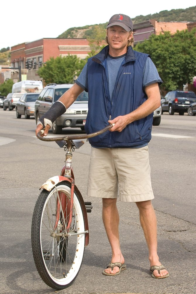 Kyle Pietras stands along Lincoln Avenue with the vintage bicycle he uses to commute. He plans to run for the at-large seat on the Steamboat Springs City Council this November on a pro-growth, pro-business platform.