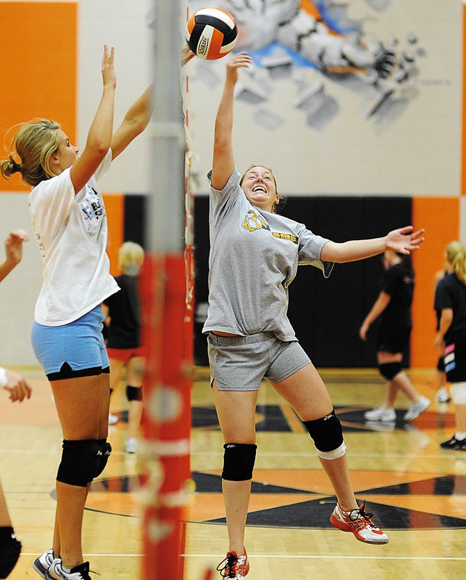 Hayden's Samantha Huffar, right, tries to power the ball over Erin Koehler on Wednesday as the Tigers volleyball team practices in the Hayden High School gymnasium. The team will try to carry on success from last season, when it went 16-6.