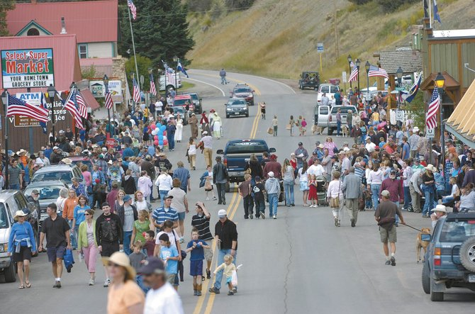 Residents fill Main Street in Oak Creek after the 2008 Labor Day Parade. Children's events will be free at this year's celebration.