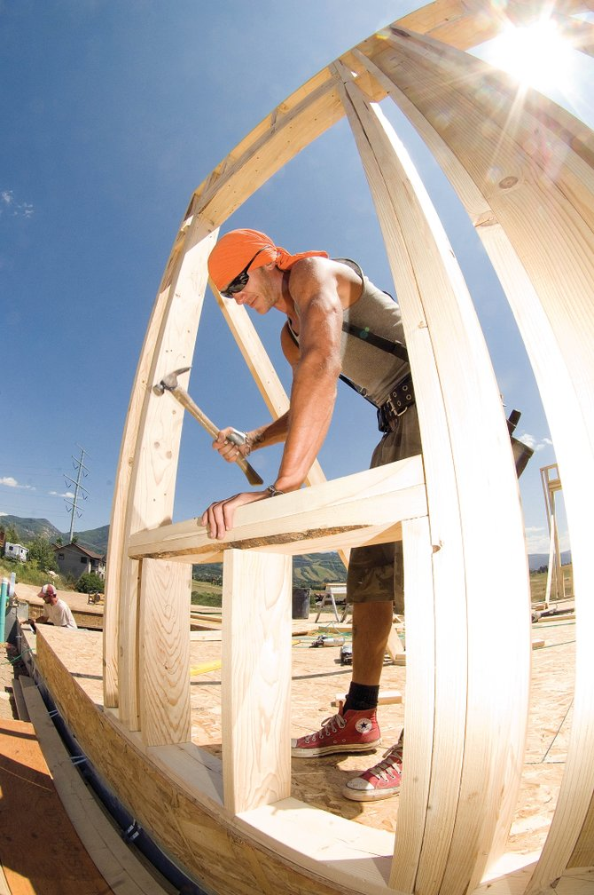 Construction worker Justin Hayes frames a house in Steamboat Springs. The downturn in housing has slowed building in Steamboat Springs. Hayes, and many others like him, is hoping for a bright future in the housing and construction industry.