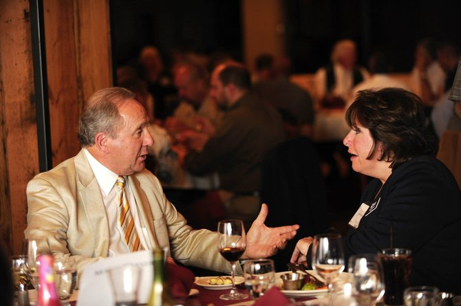 Michael Reagan, former conservative talk radio show host and son of late President Ronald Reagan, chats with Shari Williams, president of the Leadership Program of the Rockies, on Friday evening during the Steamboat Institute's inaugural Freedom Conference dinner at the top of the gondola. Reagan gave the keynote speech at the dinner.