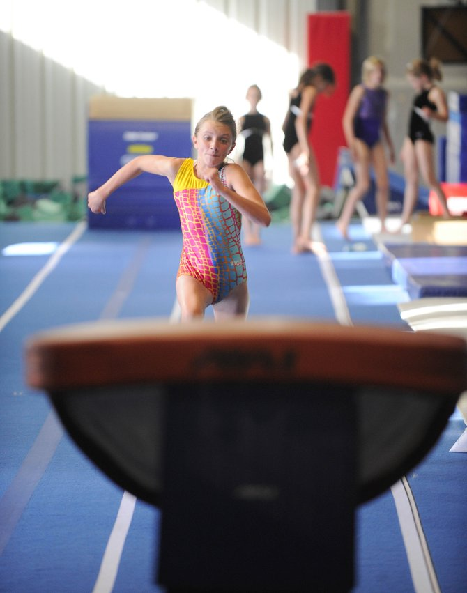 Twelve-year-old Maggie McElhiney practices Thursday in preparation for an upcoming meet.