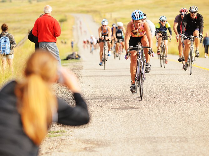 Kathy McGowan, of Snowmass Village, leads a pack of riders up the final hill of the 20-mile bike section of the Steamboat Triathlon.