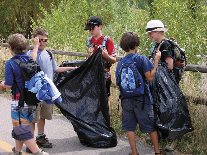 Fifth- and sixth-graders from Lowell Whiteman Primary School helped clean the Yampa River Core Trail last week during a three-day camping trip at the head of Sleeping Giant. From left are Wyatt Gray, Wilder Gray, Liam Hahn, Hill Fitzgerald and Andrew Matthews.