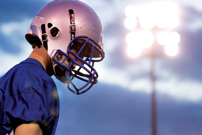 Braeden Sullivan lines up Thursday night during Moffat County High School's football practice. The Bulldogs will battle Berthoud High School at 7 p.m. today at the high school, 900 Finley Lane.