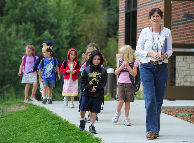 Soda Creek Elementary School teacher Beth Leech leads her class outside after school Friday. Enrollment in Steamboat Springs schools increased slightly this year despite the economic recession, which some administrators thought would have caused families to leave Steamboat.