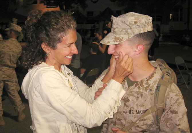 Marcus Tarzian, a 2006 graduate of Steamboat Springs High School, is greeted by his mother, Talina Tarzian, on Aug. 21 at Camp Pendleton in California after returning from a tour in Iraq with the U.S. Marine Corps. Talina Tarzian and Mark Tarzian, Marcus' father, own and operate the Windemere Landscape & Garden Center in Steamboat. Marcus Tarzian will arrive in Steamboat on Sept. 20.
