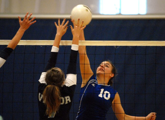Annie Sadvar, right, a Moffat County High School sophomore, spikes the ball Saturday against Valor Christian High School at the Regis Jesuit Jam volleyball tournament in Lakewood. MCHS lost the match, 3-1. The Bulldogs won 3 of 4 matches at the event.
