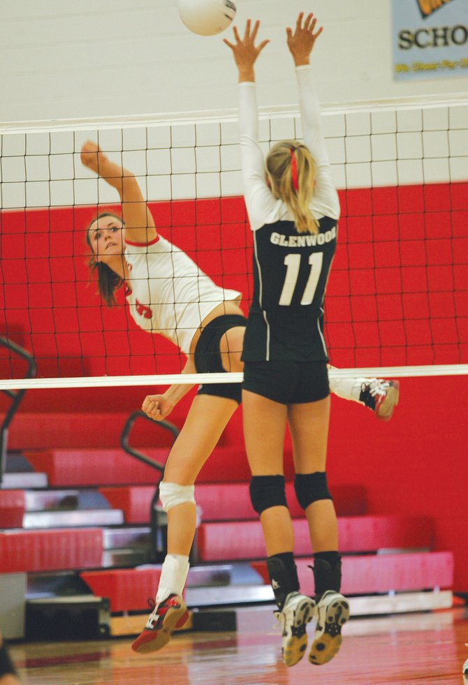 Steamboat Springs senior Colleen King directs the ball past Glenwood Springs junior Taylor Nicola in Saturday's Demon Invitational championship match.