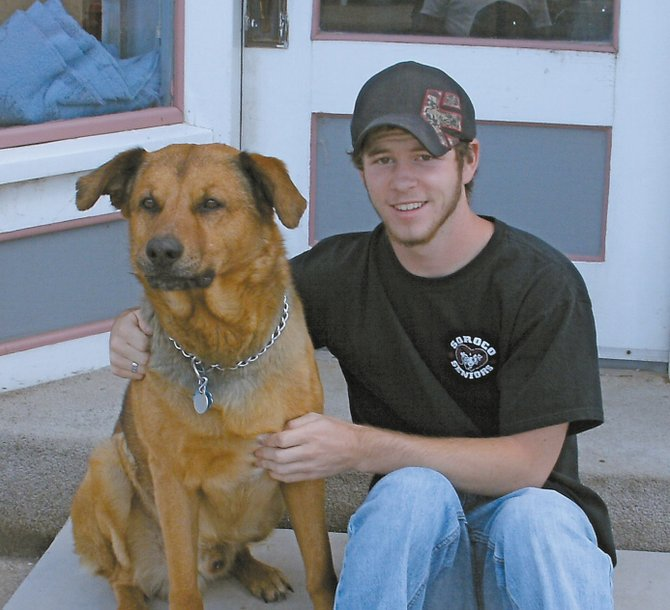 Joe Kelly sits with his dog, Amos, in front of his Yampa home 10 years after he was featured in the South Routt NOW newspaper on his golden birthday on 9-9-1999, when he turned 9. Kelly will turn 19 today, on 9-9-2009.