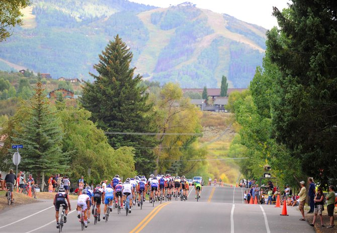 Men's pro division cyclists head down Oak Street on Monday afternoon during the Steamboat Ski & Bike Kare Criterium event, which was the last event of the four-day Steamboat Springs Stage Race.