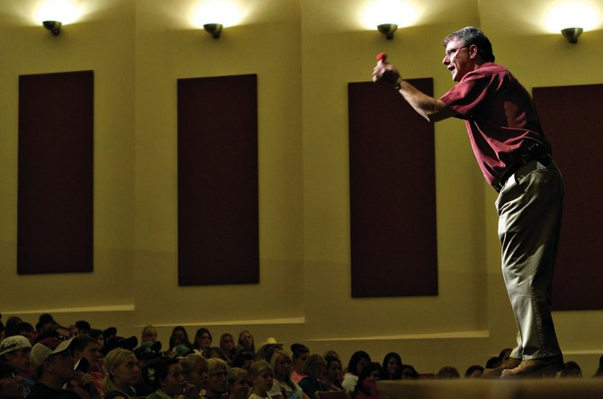 Motivational speaker Tim Piccirillo talks Tuesday to the Moffat County High School student body. Piccirillo used magic and personal stories to illustrate his message of setting goals, aiming high and understanding one's potential.