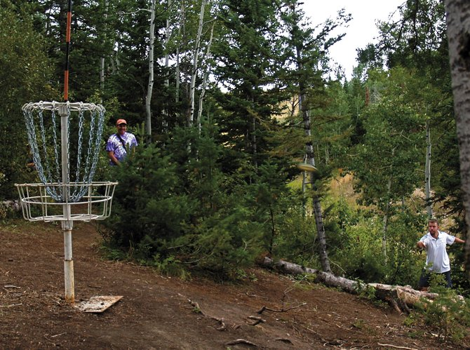 Mitch Sonderfan, of Erie, putts for birdie on hole No. 8 during last weekend's Steamboat Open disc golf tournament at Steamboat Ski Area.