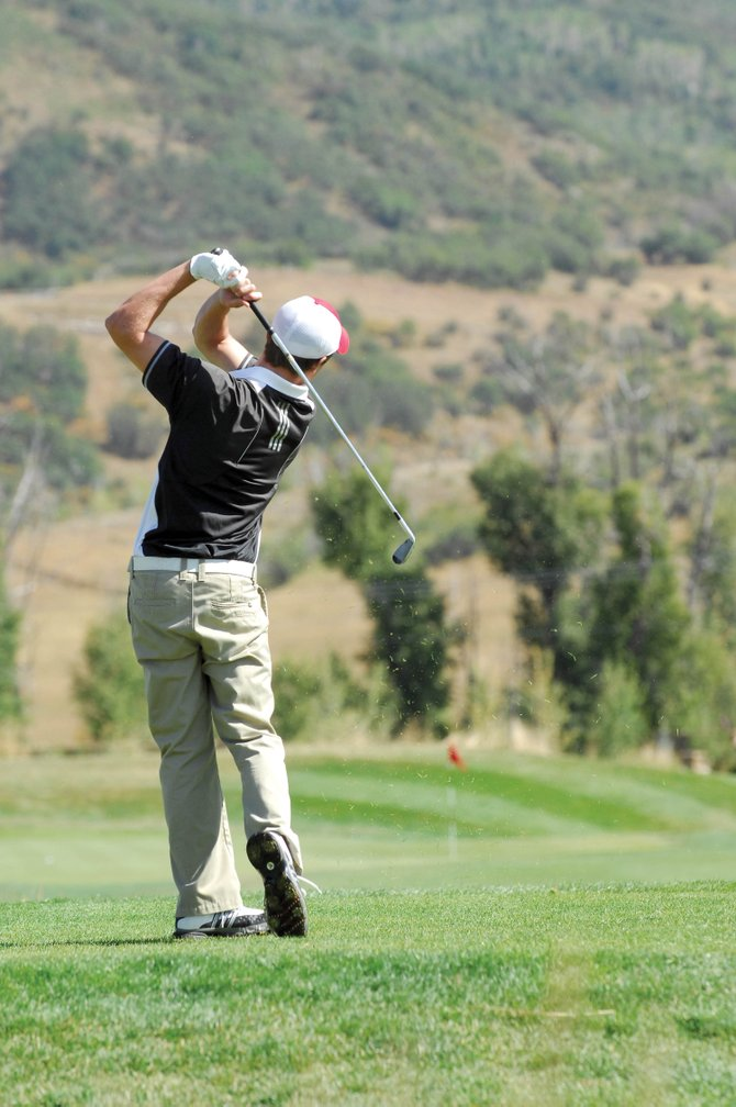Steamboat Springs High School's Kaelen Gunderson watches his tee shot fly toward the No. 7 hole Wednesday during the annual Steamboat Sailors Invitational at Haymaker. Gunderson's 71 won the tournament.