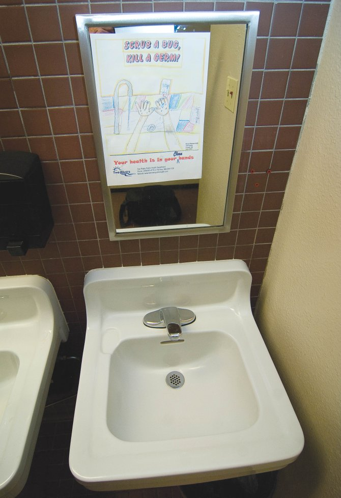 Signs posted in the bathrooms at Strawberry Park Elementary School encourage students to wash their hands. Regular hand-washing is one of the best ways to combat the spread of flu in Steamboat Springs.