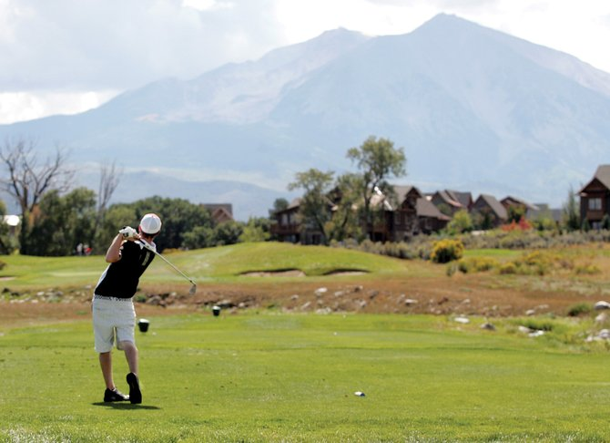 Steamboat Springs High School's Scott Ptach tees off at River Valley Ranch Golf Club in Carbondale on Monday. The Sailors earned their second title in a row.