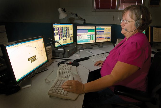 Routt County communications supervisor Lorie McCarty works Tuesday afternoon in the dispatch center. Routt County will upgrade its Computer Aided Dispatch system with a $1.5 million grant from the Colorado Department of Transportation.