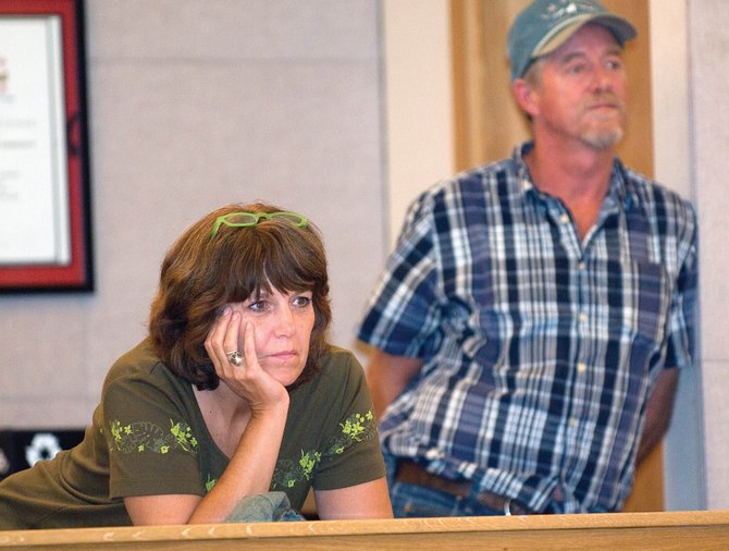 West Acres Mobile Home Park resident Terri Carpenter, left, and Tom Armstrong listen during public comment at Tuesday evening's Steamboat Springs City Council meeting. The residents are upset about plans to build a road through dedicated greenbelts in the mobile home park.