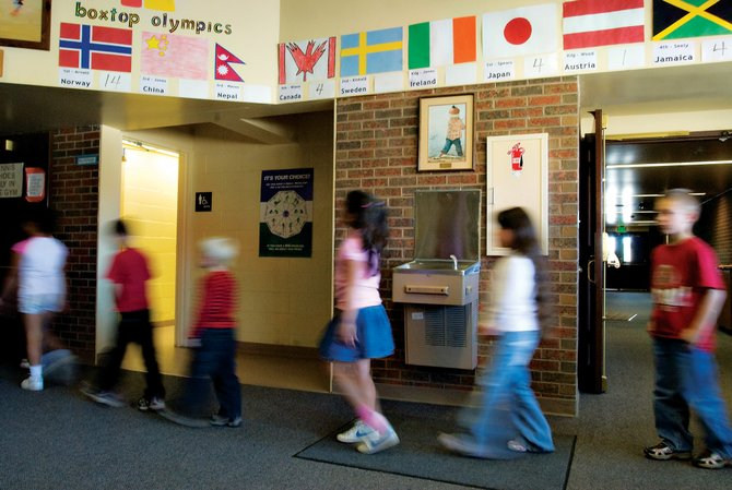 Sunset Elementary School first-graders make their way to gym class Thursday. About one-third of Moffat County elementary school classrooms are larger than the target size. For the larger classes, extra paraprofessionals are added during critical lessons.