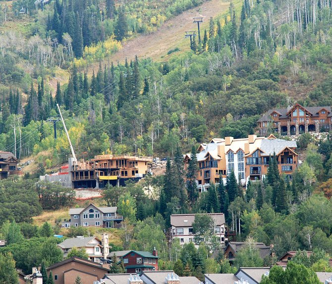 The Emerald Properties duplex on Ski Trail Lane is the large roofed building under construction in the right center of the photograph. It is built on a lot with a challenging 34 percent grade; each home in the duplex has six bedrooms and 6.5 bathrooms.