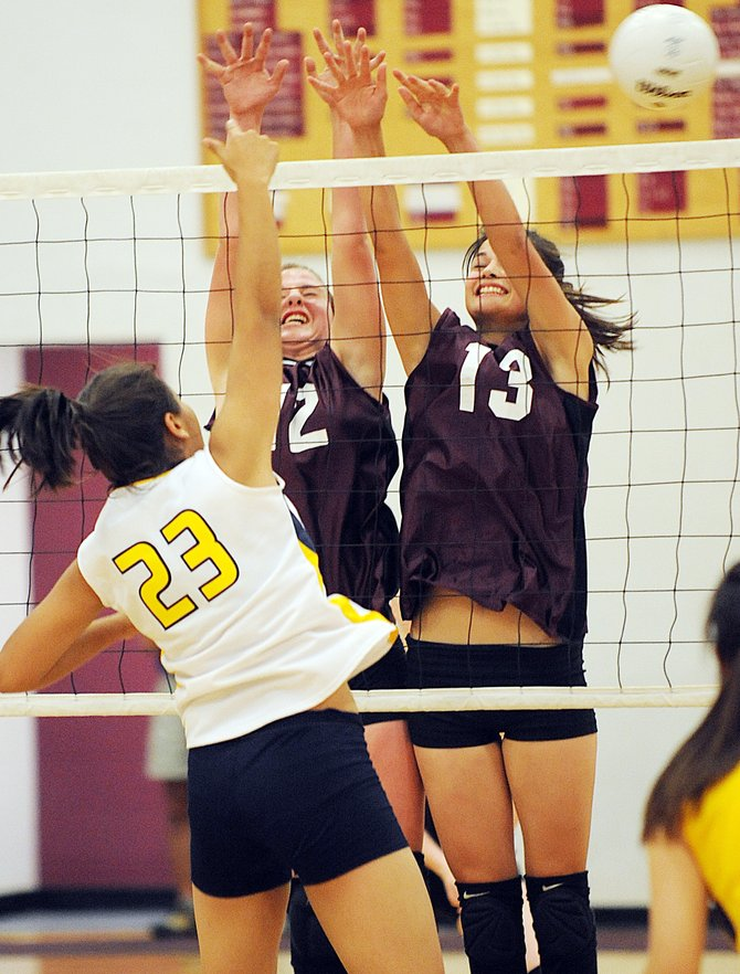 Soroco's Shelby Miles, left, and Ceanna Rossi try to block North Park's Lucia Banuelos on Thursday as the Rams fell in three games to the Wildcats. Soroco returns to action at 5 p.m. today against DeBeque at home.