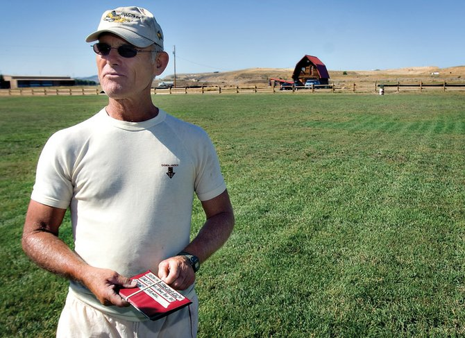 Bill Sawer talks Friday about the soccer fields he's building in front of his house at 2303 W. First St. Sawer funded the soccer fields with his own money, and the property features a practice field, futsal field and game field.