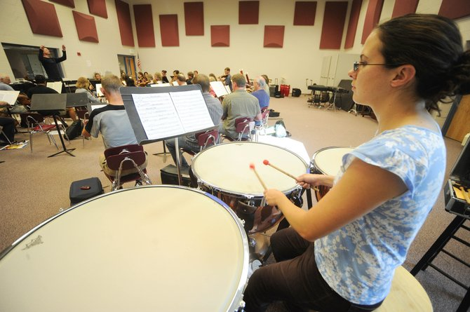Jennie Dorris, of Denver, hits the timpani during a Steamboat Springs Orchestra practice Friday at Steamboat Springs High School. The group performs at 7:30 p.m. today at the Strings Music Pavilion.