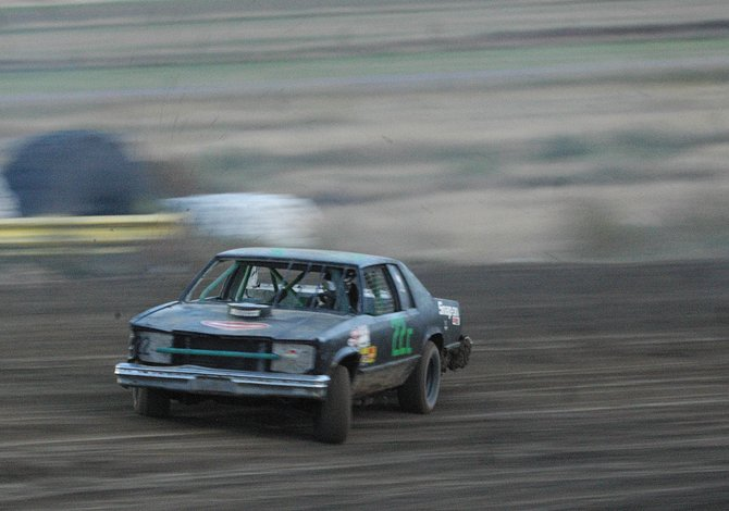 Heath Chamberlain navigates through turn three Saturday at the Hayden Speedway. Saturday was the last day of racing this year at the track.
