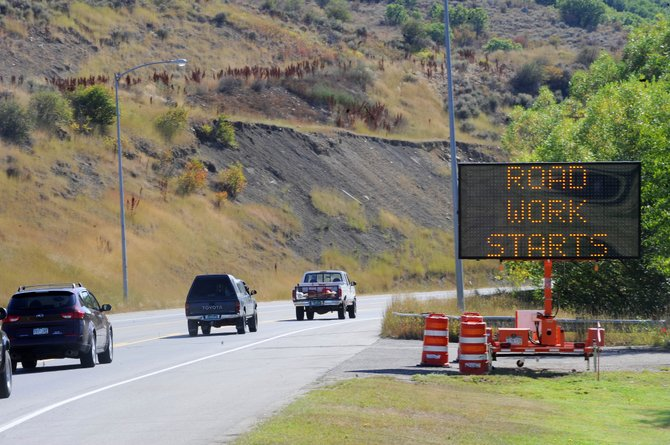 A sign along U.S. Highway 40 alerts passing motorists about road work on the highway that will begin this week. The Colorado Department of Transportation will hold a meeting tonight to provide residents and local businesses with answers about the project.