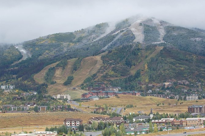 A light dusting of snow - the first of the season - covers the upper part of the Steamboat Ski Area on Monday morning. A cold front brought snow and falling temperatures to the Yampa Valley on the last official day of summer.
