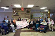 The residents at Sandrock Ridge Care & Rehab donated a quilt Tuesday to the Yampa Valley Pregnancy Center. The quilt, which is one of the activities residents participate in and took about two years to complete, will be given to a baby girl.