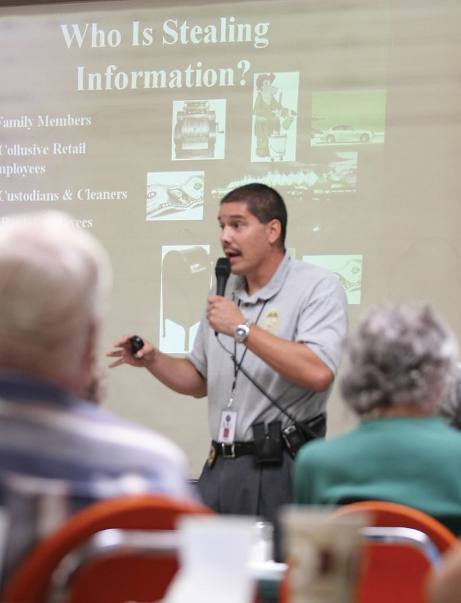 John Zamora, of the Colorado Bureau of Investigation, educates Moffat County residents about the growing risk of identity theft Wednesday at American Legion Post 62. The presentation was part of the Northwest Colorado Visiting Nurse Association's Aging Well Program.
