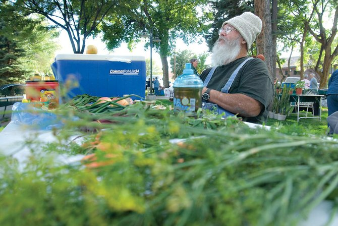 Bob Grubb, of Craig, sells his wares Thursday at the final Farmers Market of the 2009 season at Alice Pleasant Park. The Downtown Business Association's market finished its third year this year.