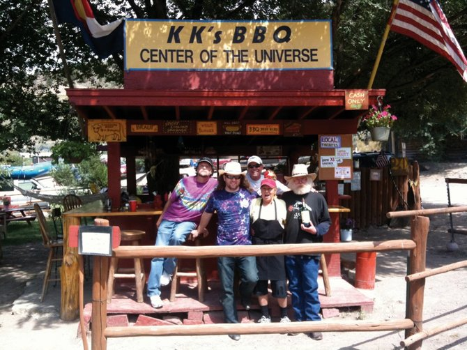 Grateful Dead tribute band Shakedown Street plays at 9 p.m. today and Saturday at Ghost Ranch Saloon. Here, drummer Jake Wolf, second from left, joins original band members Rick Starkey, far left, and Ted Galloway, far right, at KK's BBQ in Rancho del Rio with the restaurant's owners.