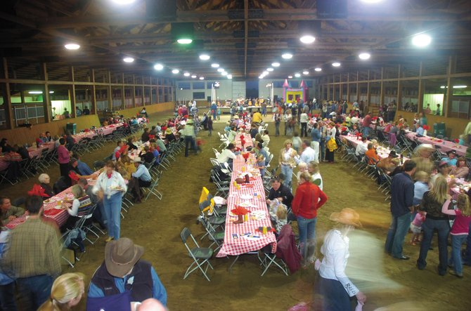 Last year's Community Barbecue and Barn Dance brought a colorful crowd to the horse arena at Sidney Peak Ranch. This year's event starts at 5 p.m. Saturday. The cost is $35 per person or $75 for a family.