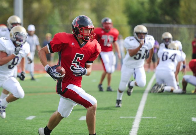 Jack Spady runs the ball up the field during Steamboat's Aug. 29 game against Holy Family. The Sailors will play the Eagle Valley Devils at 7 p.m today.