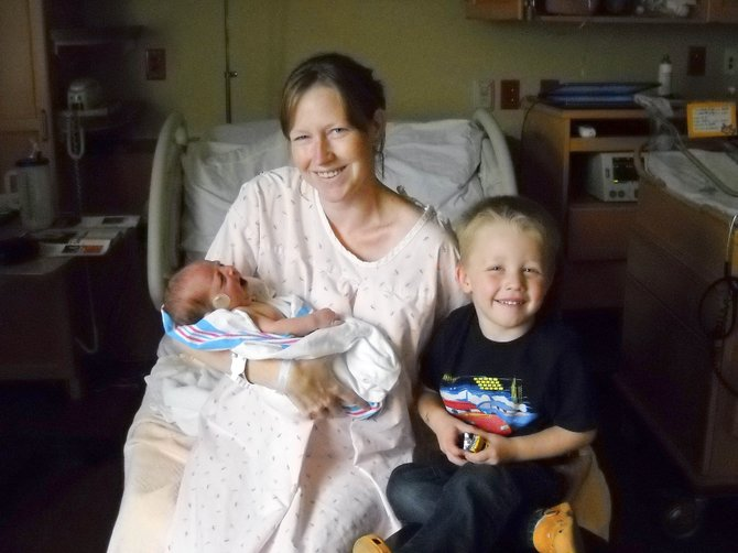 Samantha Youngs gave birth to Joseph Patrick Paul Youngs in the front passenger seat of her mother's Subaru at about 4:30 a.m. Monday. At right is Youngs' firstborn son, Graham Youngs.