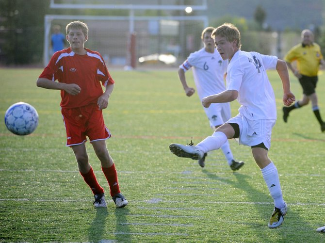 Steamboat soccer player Sam Glaisher takes a shot at the goal during Thursday's game against Glenwood Springs. The teams tied at 0.