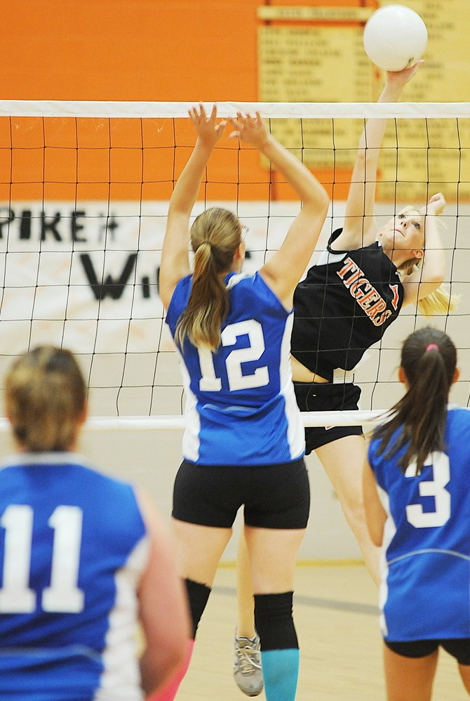 Hayden's Ashlee Doolin smashes a kill in Friday's four-game match victory against De Beque.
