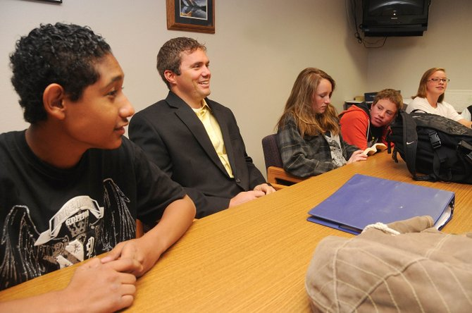Steamboat Springs High School resource officer Josh Carrell, center, visits with his freshman anchor class students, from left, Carlos Hernandez, Ali Pougiales, Alex Alfone and Lizzie Fulton on Wednesday.