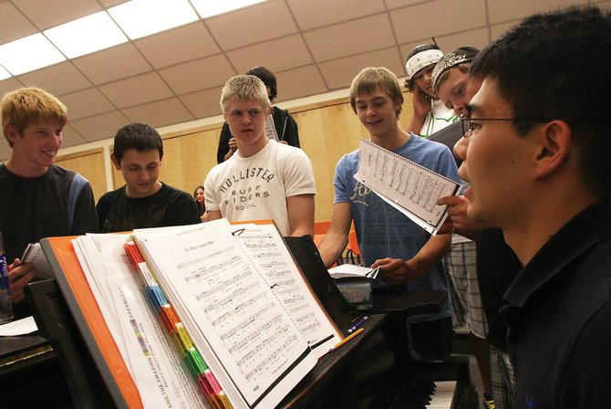 "Dan Mullens, Moffat County High School's musical director, seated at the piano, works on a song with the brothers group Tuesday. The brothers are one of three ensembles that will perform during the fall musical, ""Joseph and the Amazing Technicolor Dreamcoat."""