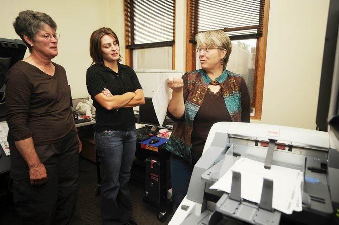 Routt County Elections Supervisor Vicki Weber, right, shows volunteers, from left, Tresa Moulton and Julie Franklin a flawed ballot that the scanner recognized during a test of the equipment Wednesday at the Routt County Courthouse.