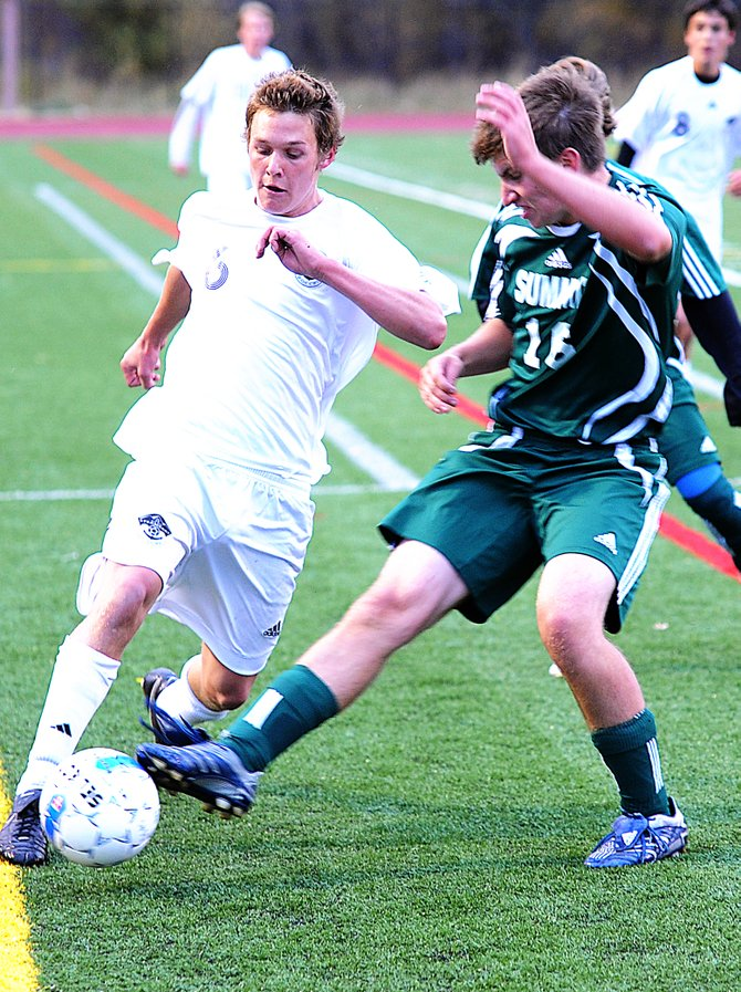 Andrew White, left, tries to get the ball past Summit's Matt Truesdale on Wednesday as the Tigers beat the Sailors, 2-1.