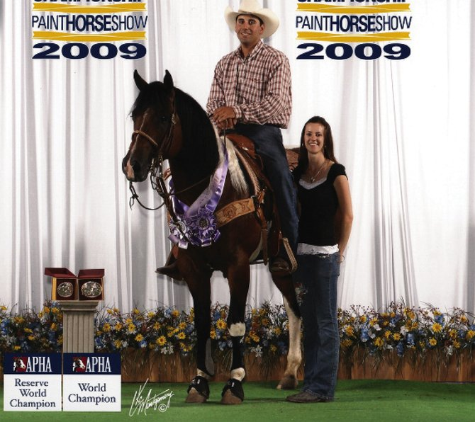 Buster, a Bay Tobiano Stallion, was named a world champion in the junior steer stopping division at the American Paint Horse Association's 2009 Summer World Championship, June 24 through July 4 in Fort Worth, Texas. Craig residents Ron and Marie Kettle own the horse, which is shown above with Nick and Chelsea Pullara, who were his trainers.