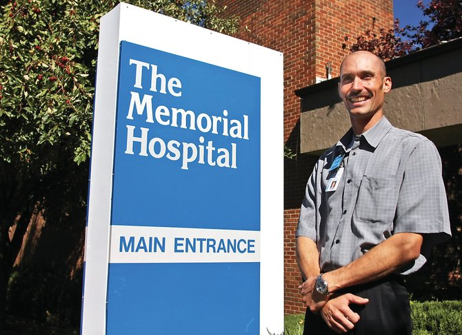 Brian Chalmers, The Memorial Hospital's new chief financial officer, stands in front of the facility's main entrance Friday. Chalmers moved to Craig with his wife and four sons from Choteau, Mont., and has worked in health care for 10 years.