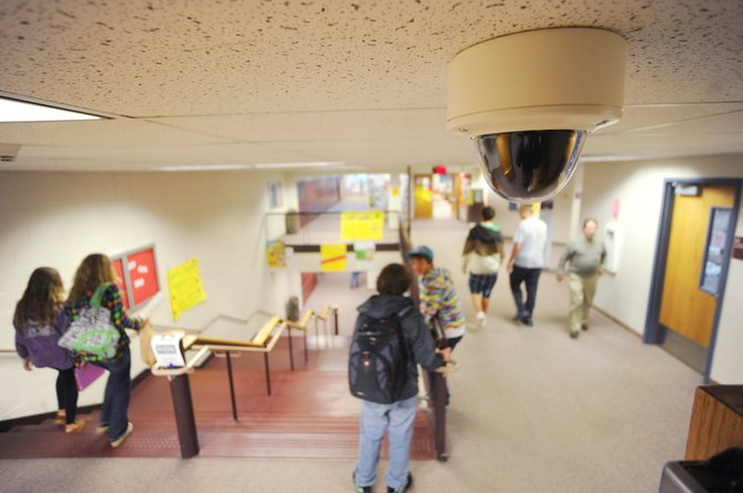 Steamboat Springs High School students pass through the halls under one of the new security cameras installed throughout the school.