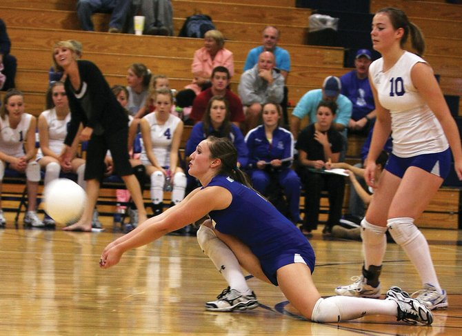 Jessica Matthews, left, a Moffat County High School junior, keeps the ball alive while sophomore Annie Sadvar backs her up during Saturday's match against Delta High School. The Bulldogs beat the Panthers in three games.